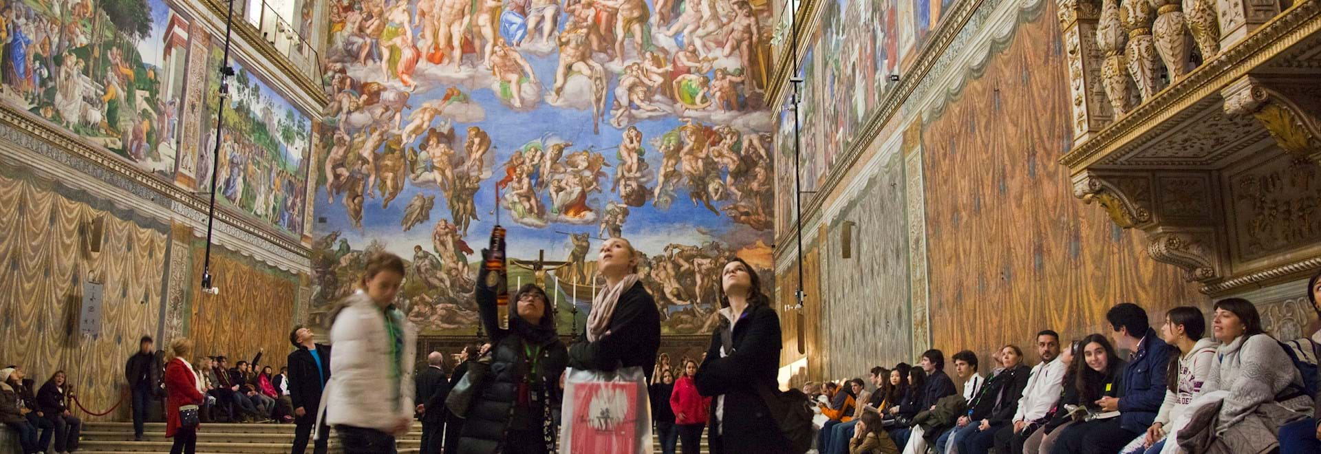 Group looking to Sistine Chapel's ceiling