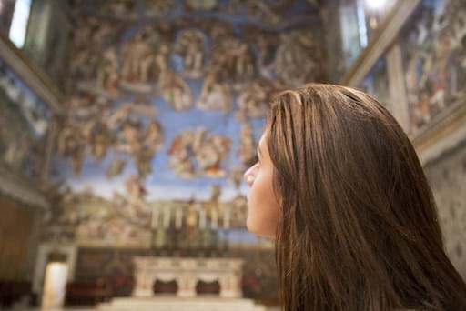 Girl looking at the Sistine Chapel
