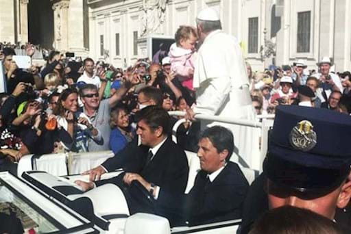 Pope in his popemobile greeting the crowd