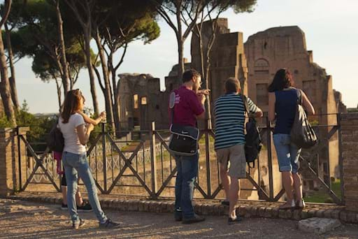 Guide with group in Palatine Hill