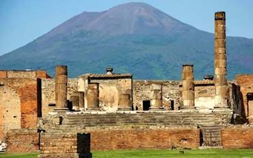 Ruins of the old city of Pompeii and Mt. Vesuvius at the back, Italy