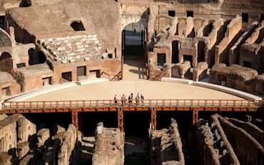 Colosseum Arena floor with tourists in Rome