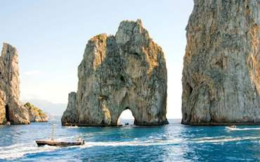 Famous Faraglioni rocks at the coast of Capri