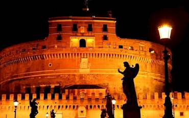 Castel Sant' Angelo at night with a view from the Bridge of Angels