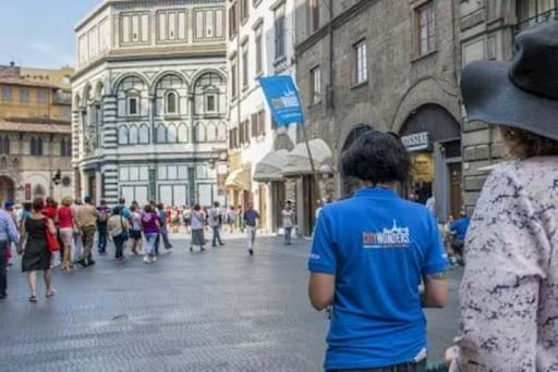 Tourists visiting Piazza Duomo in Florence