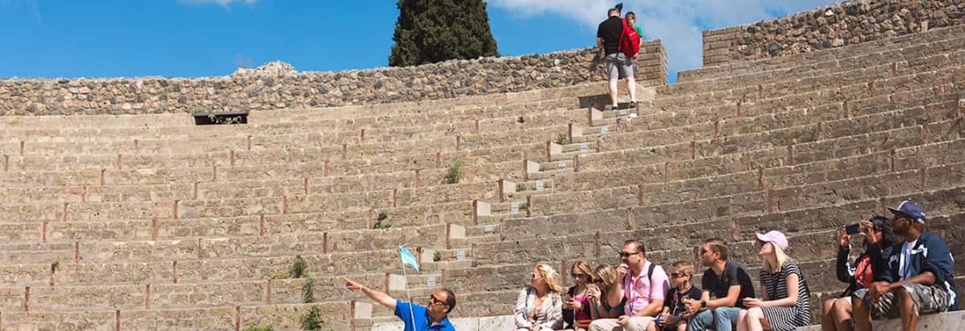 Pompeii group tour listening to expert City Wonders guide at the ruins of the Pompeii Amphitheatre