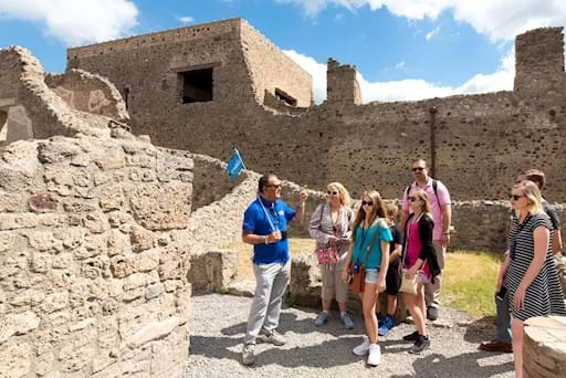Pompeii group tour on one of the many preserved streets of Ancient Pompeii