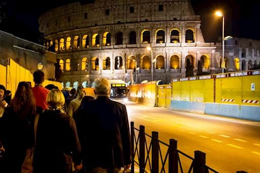 Tourists going to the Colosseum at night
