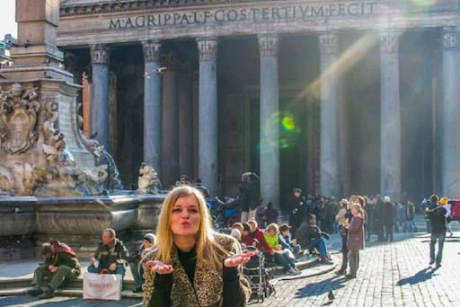 Girl outside the Pantheon blowing a kiss